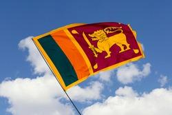 Sri Lanka flag isolated on sky background with clipping path. close up waving flag of Sri Lanka. flag symbols of Sri Lanka.