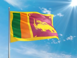 Sri Lanka national flag waving in the wind against deep blue sky. High quality fabric. International relations concept.