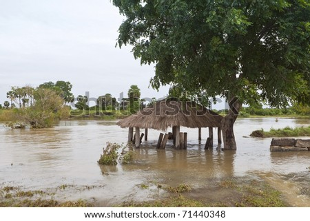 sri lankan landscape with a police army checkpoint submerged by flood waters