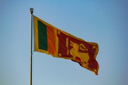 Srilankan National flag flying high at presidential office. srilankan national flag represents tamils, muslims, sinhalese and christians.