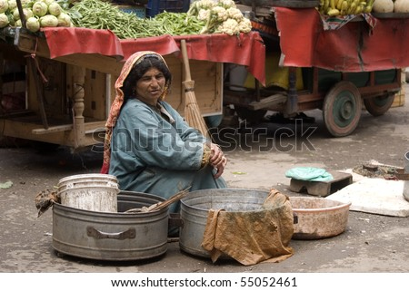 SRINAGAR, INDIA - APRIL 29: Local woman selling her products in the morning market on Dal Lake, April 29, 2010 in Srinagar, Kashmir, India