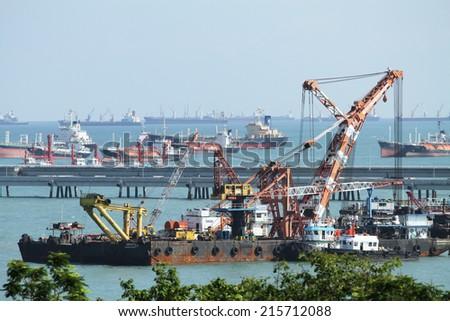 SRIRACHA - THAILAND - JUNE 17, 2014 : Big ships in the Laemchabang seaport on June 17, 2014 in Sriracha province, Thailand