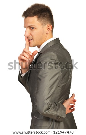 Ssh! Liar business man taking a oath isolated on white background - stock photo