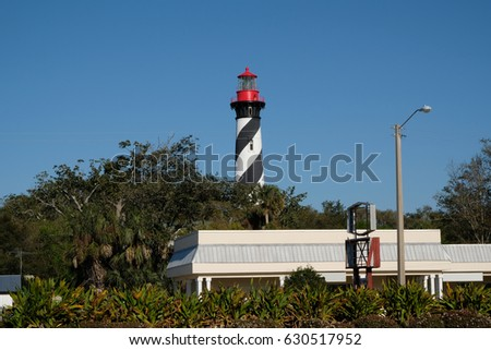 Shutterstock St Augustine Light Station Lighthouse near St Augustine Beach, Florida.  Black and white striped lighthouse with red cupula. Functional lighthouse built in 1874 in St Augustine. Blue, cloudless sky