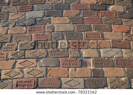 ST. AUGUSTINE, USA - April 26, 2011: Bricks used to construct the Old Brick Road. The name of the manufacture can still be read. The company existed from 1901 - 1920.