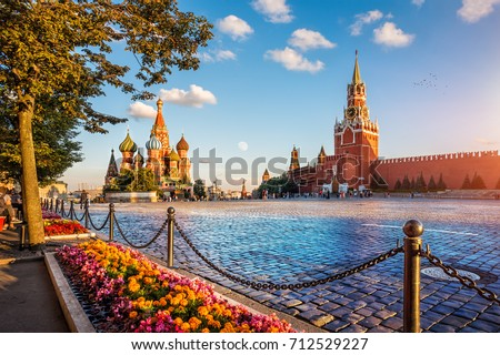 St. Basil's Cathedral and Spassky Tower on Red Square in Moscow on a summer evening and colorful flowers #712529227