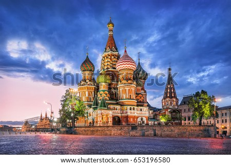 St. Basil's Cathedral in Moscow on Red Square on a summer evening and a blue cloud #653196580