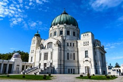 St. Charles Borromeo Cemetery Church with blue sky and clouds in Vienna Central Cemetery in Austria