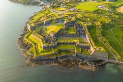 St. Charles Fort Kinsale Cork Ireland, amazing aerial scenery view on coast line and old Irish touristic landmark town at sunset