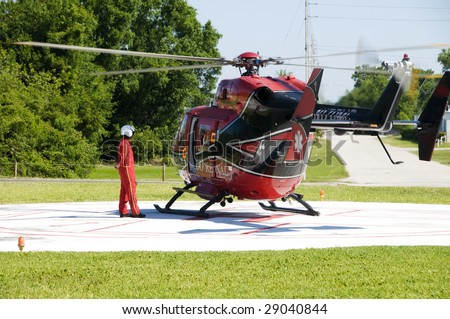 ST. CLOUD, FL - APRIL 13: An unidentified crew member of the Orlando Regional Healthcare Helicopter waits for a emergency call at St. Cloud Hospital on April 13, 2009 in St. Cloud. Florida.