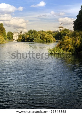 St. James Park lake with Horse Guards and London Eye in the background.