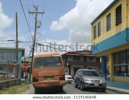 ST. JOHN'S, ANTIGUA AND BARBUDA - JUNE 14, 2018: On a streets of capital city St. John's in Antigua. St. John's is the capital and key port of the Caribbean island nation of Antigua and Barbuda. #1119140648