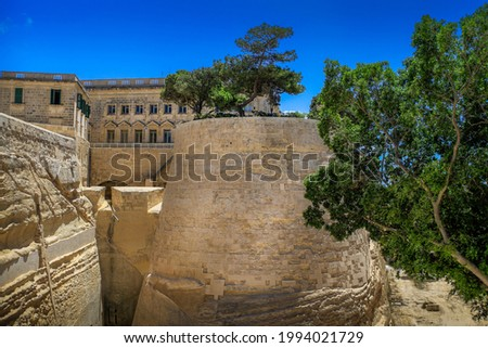 St John's Bastion in the ancient city walls of Valletta and the rear facade of the Central Bank of Malta Currency Museum. Stock photo ©