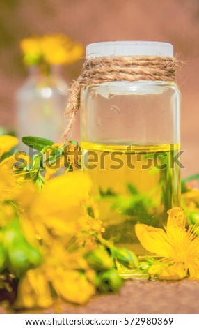 St. John's wort tincture in a small bottle.  #572980369
