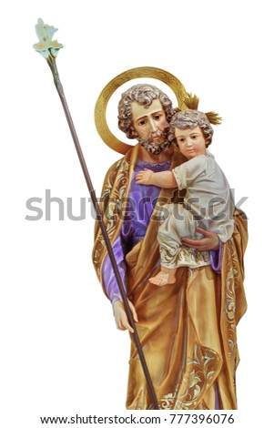 St Joseph holding the Christ child statue isolated