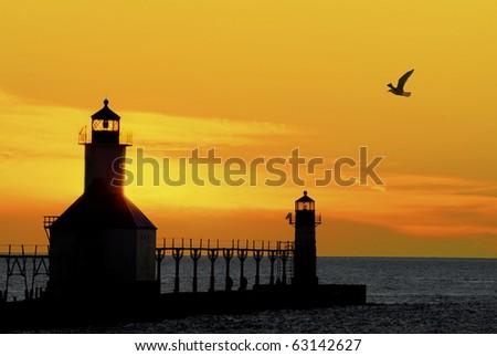 St. Joseph North Pier Lights in St. Joseph, Michigan at sunset.