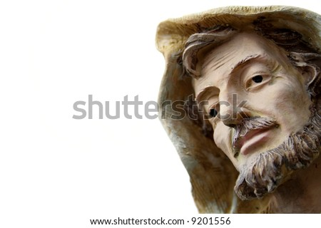 St Joseph statue up close of his  face only isolated on a white background.