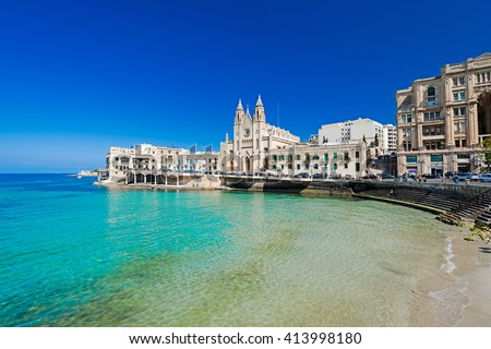 ST JULIANS, MALTA - APRIL 13, 2014: Our Lady of Mount Carmel Church on Balluta Bay in St. Julian's, Malta on April 13, 2014. #413998180