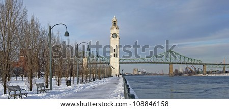 St. Lawrence River with Big Ben in Old Montreal, and Jacques-Cartier Bridge in background, winter season