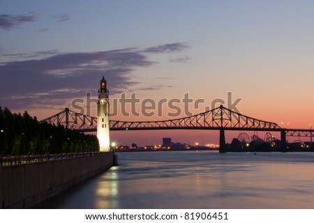 St. Lawrence River with Big Ben in Old Montreal, and Jacques-Cartier Bridge in background, with a beautiful sunrise.