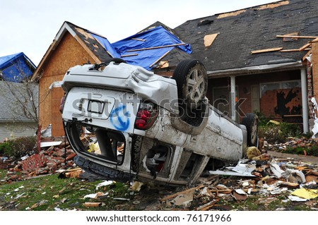 ST. LOUIS - APRIL 25, 2011: Cars and homes were heavily damaged by a tornado that swept through Maryland Heights in the suburbs of St. Louis on Good Friday, April 22, 2011.