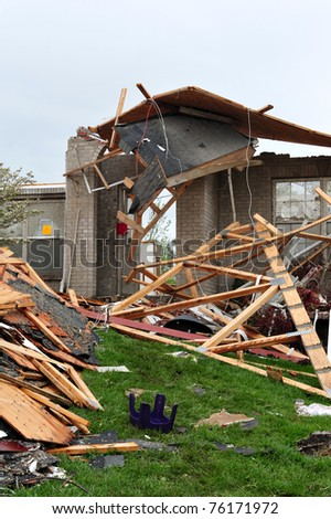 ST. LOUIS - APRIL 25, 2011: Precarious remnants of a house stand in testament to the fierce tornado that swept through Maryland Heights in the suburbs of St. Louis on Good Friday, April 22, 2011.