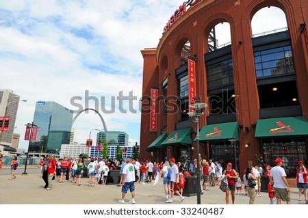 ST LOUIS – MAY 23: Baseball fans walk near Busch Stadium on May 23, 2009 in St Louis, Missouri. Busch Stadium is the home of the Saint Louis Cardinals.