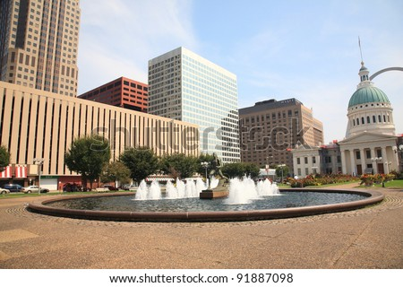 ST. LOUIS, MISSOURI -  SEPTEMBER 18: The Running Man Statue in Kiener Plaza Gateway Mall near the famous Arch, on September 18, 2010. The Old Courthouse was completed in 1864 and is 192 feet high.