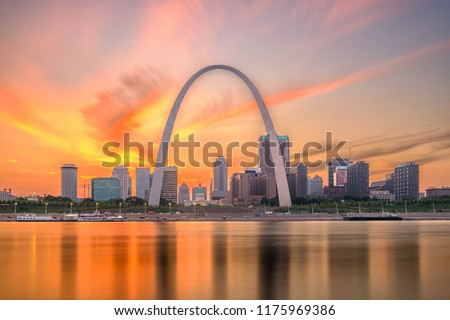 St. Louis, Missouri, USA downtown cityscape on the river at dusk.