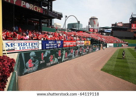 ST. LOUIS - SEPTEMBER 18: Cardinals fans vie for batting practice home run baseballs before a National League game at Busch Stadium against the San Diego Padres on September 18, 2010 in St. Louis.