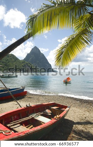 St. Lucia island view of famous twin piton mountain peaks from Soufriere beach native fishing boats in Caribbean Sea