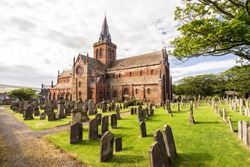 St Magnus Cathedral and surrounding gothic graveyard in Kirkwall, Orkney Islands, Scotland. The holy red sandstone architecture is part of the church of Scotland