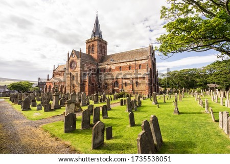 St Magnus Cathedral and surrounding gothic graveyard in Kirkwall, Orkney Islands, Scotland. The holy red sandstone architecture is part of the church of Scotland stock photo