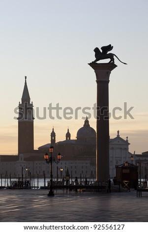 St. Mark's column on Piazza San Marco (Piazzetta di San Marco) in Venice with the Santa Maria della Salute church in the background at dawn