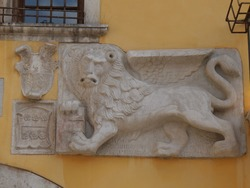 St. Mark's lion in Muggia :  situated in the facade of Town Hall building in Marconi Square