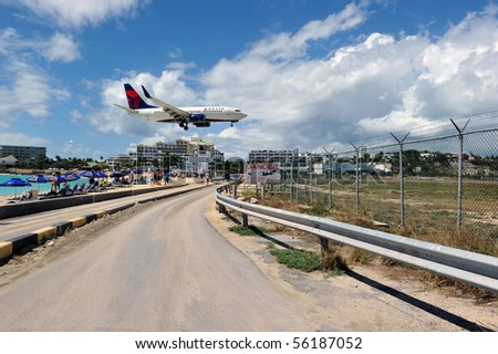 ST MARTIN - JUNE 26: Delta expansion gives more places to choose in the Caribbean. New destinations are Georgetown, Grand Cayman, Grenada. Here is new 73W about to land at St Martin on June 26, 2010.