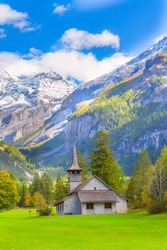 St. Mary Church, Kandersteg, Bernese Oberland, Canton of Bern, Switzerland, Europe, autumn trees and snow mountain peaks