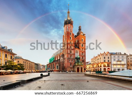 St. Mary's basilica in main square of Krakow with rainbow #667256869