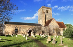 St Mary's Church at Cholsey in South Oxfordshire, England, viewed from the graveyard aginst a blue Autumn sky