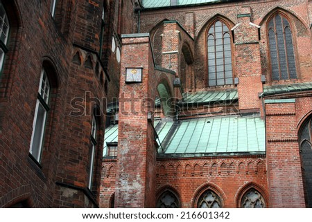 St. Mary\'s Church Luebeck, detail of architecture, brick gothic, side nave, gothic windows, copper roof and sundial