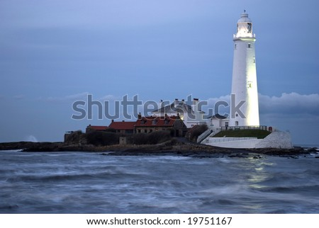 St Marys Lighthouse at sunset with the causeway covered