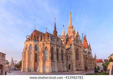 St. Matthias church in Buda Castle district on blue sky, built at the heart of Buda's Castle District, Budapest, Hungary  #413982781