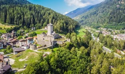 St. Michael castle in Ossana stands on a rocky outcrop. Ossana castle in the village of Ossana in Val di Sole, Trentino Alto Adige, Italy. Panoramic view
