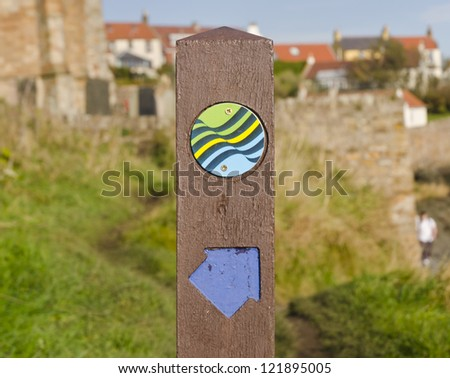 ST MONANS, SCOTLAND - OCTOBER 21: a waymarker shows the continuation of the Fife Coastal Path on October 21, 2012 in St Monans, Scotland. The Fife Coastal Path runs for 190 km along the coast of Fife.