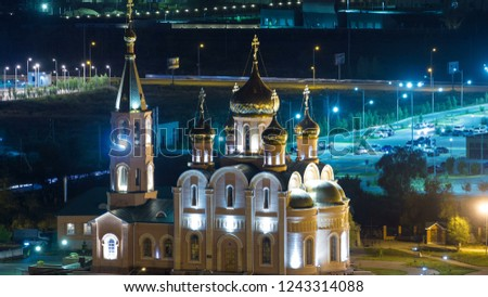 St. Nicholas Cathedral of the city of Aktobe at night timelapse. Aerial top view from above. Kazakhstan