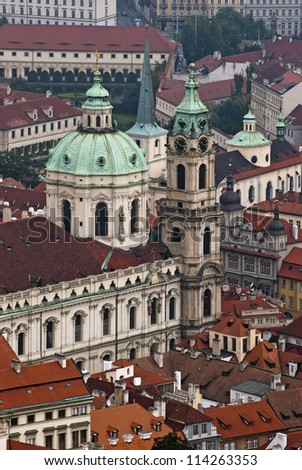 St. Nicholas Church and the red roofs in Lesser Town, Prague, Czech Republic #114263353