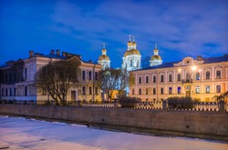 St. Nicholas Naval Cathedral in St. Petersburg and the Griboyedov Canal under the blue night sky