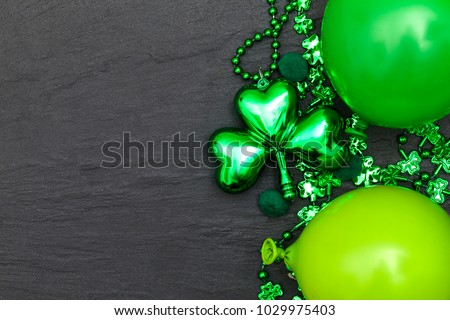 St Patrick's day background with green balloons and shamrock
