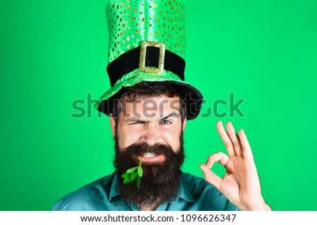 St Patrick's Day. Bearded man in green men hats celebrate Patricks Day. St Patrick's Day Party. Green men hat or top hats. Green hat with clover. Saint Patrick having fun. Ireland traditional.
