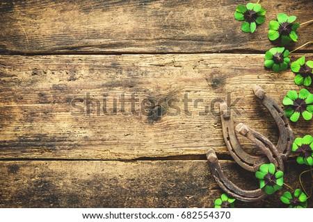 St. Patrick's day. Horseshoe and shamrock on wooden background